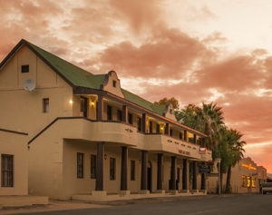 Image of the front of the hotel at sunset
